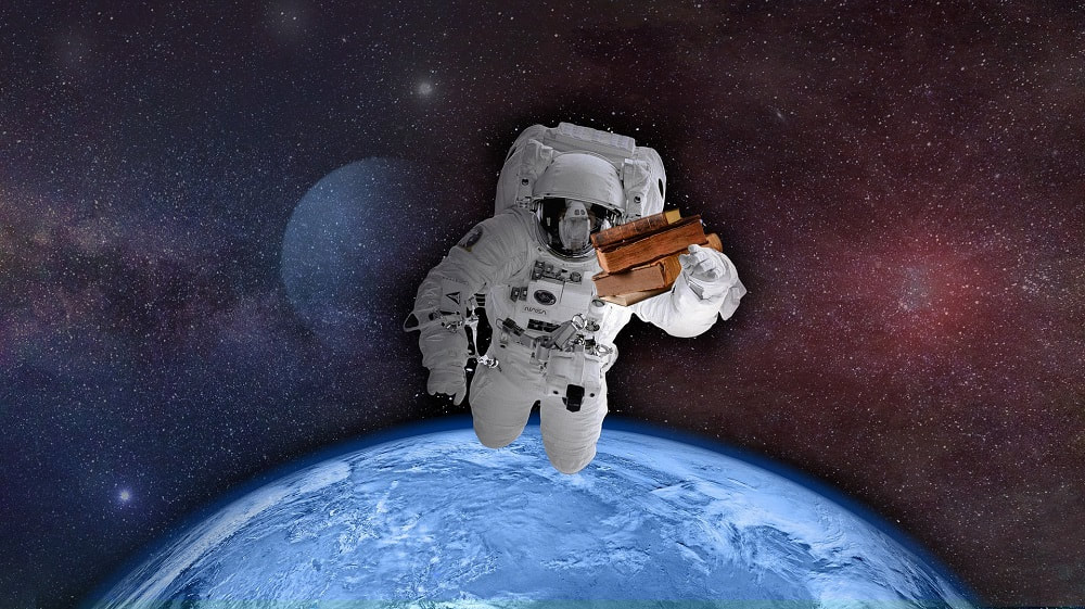 An astrounaut flying through space, holding some books in one hand. Behind him, the earth is partially visible.