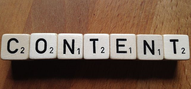 Photo with scrabble pieces spelling out the word Content