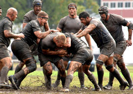 photo of men tackling in a game of rugby