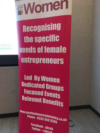 a pop up banner advertising the womens conference for Your Business Community event
