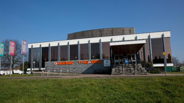 Exterior landscaped photograph of the outside of the Queens Theatre in Hornchurch