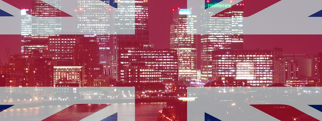 British flag with city skyline in the background